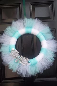 Such a cute winter wreath on Etsy, only $30.00  It would look so cute on my door!