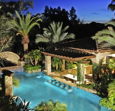 Resort style living.  Pool with waterfalls and wet bar seating in Paradise Valley.
