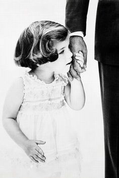 Caroline Kennedy and her Daddy J.F.K. (this has to be the most touching father-daughter photo and moment ever)...
