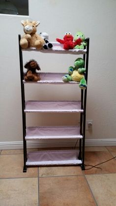 DVD rack repurposed into a stuffed animal rack. Perfect for beanies!