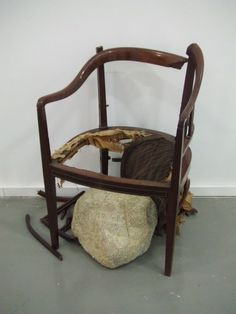 JIMMIE DURHAM   A Meteoric Fall to Heaven, 2000    armchair and stone, 33 1/2 x 19 1/2 x 25 1/2 inches