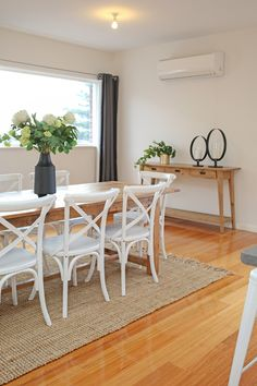 Contemporary dining, family home, polished floorboards, timber dining table, whi. Rug Under Dining Table, Cross Back Dining Chairs, Timber Dining Table, White Dining Chairs, Dining Room Chairs, Dining Room Furniture, Black Chairs, Cross Back Chair, Bistro Chairs