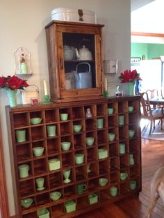 Our old post office sorting box with misc jadeite pieces and an old wall cabinet with several rare graniteware pieces.