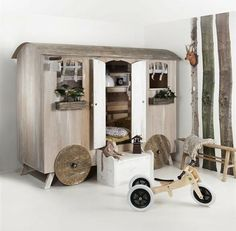 Gypsy wagon cupboard bed. Too bad the company is based in the Netherlands-makes U.S. shipping a bit impractical, but what a cute idea!