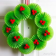 Deck the halls with a very merry paper fan Christmas wreath! Plus lots more DIY wreaths and ideas ...