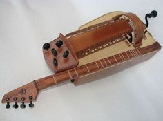 Curious (Dulcimer and hurdy-gurdy all in one) Banjo, Ancient Music, Hurdy Gurdy, Hammered Dulcimer, Cigar Box Guitar, Musical Instruments, All In One, Google Search, Music Instruments