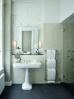 Thirties Style: pedestal sink, sconces, heated towel rack at Soho House Berlin