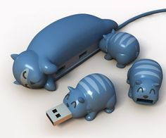 """Animal Buddy"" USB hub and flash drives.  Available in Cat, Dog, and Pig, by We Play God."