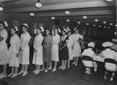 """Army Nurses shown waiting their turn to get breakfast. Nurses are fed """"Cafeteria Style""""; their food is given to them exclusive of their salary. Ft. Benning, GA 21 July 1941."""
