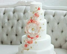 Coral wedding cake - love the gold touches