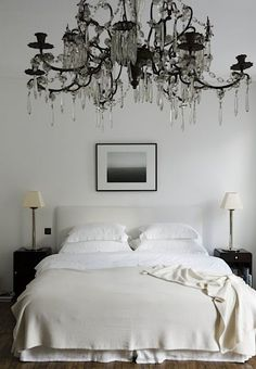 Ornate chandelier in a simple master