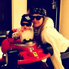 """""""What happens when daddy goes to set ... #roaddogz4life."""" --Fergie, who went for a walk on the wild side when she played dress-up with her baby boy Axl. Rebels without a cause!"""