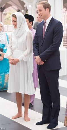 Both Prince William and Kate were attentive and eager to learn more about the mosque.