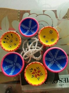 Simple diya decoration ideas for Diwali Browse beautiful diya images online on HappyShappy! Also find and save decorative diyas design photos for competition in school. Diwali Candle Holders, Diwali Candles, Diy Candles, Diwali For Kids, Diwali Craft, Diya Decoration Ideas, Diy Diwali Decorations, Creative Crafts, Diy Crafts For Kids