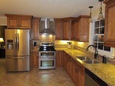 Kraftmaid Jamestown Maple cabinets in Praline  with mocha glaze....