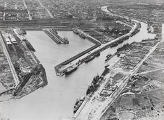 Black and white photograph depicting an aerial view of Victoria Dock, 1920-1939. It is one of a collection of fifteen black and white photographs showing passenger and cargo ships in Australian waters in the 1920s and 1930s.