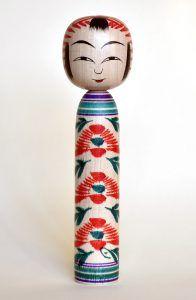 Togatta kokeshi doll by Satou Kazuo