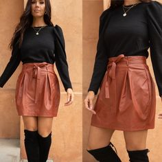 This skirt might be made from faux leather, but it's as fabulous as ever! It features a zipper closure in the back and a removable and adjustable tie at the waist. Pair this stunner with a cute, chunky sweater and some high boots and you'll be set for a day out and about. Lightweight No Stretch Through Fabric Adjustable Belt Tie Detail 100% Polyester Fits True To Size Holiday skirt christmas party haloween dressup college outfit newyears Cute Cheap Outfits, Cheap Dresses, Online Fashion Boutique, Womens Fashion Online, College Fashion, College Outfits, Holiday Skirts, Cute Clothes For Women, Junior Fashion