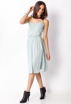Love 21 - A woven dress featuring crochet lace trim. Scoop neckline. Spaghetti straps. Elasticize...