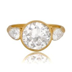 Boucheron- ca. 1960 bezel set in a beautiful yellow gold setting and shouldered by two pear-cut diamonds