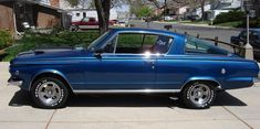 1965 Plymouth Barracuda.  My husband had a 66 or 67 that looked almost just like this.  Blue and all, only bigger tires on the back!