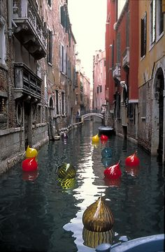 canals... and balloons floating in canals...(Chihuly in Venice)