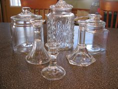 Apothecary Jar DIY - w E6000 glue...see tutorial Glass Apothecary Jars, Halloween Apothecary Jars, Glass Candy Jars, Glass Canisters, Candle Jars, Mason Jar Crafts, Dollar Tree Decor, Dollar Tree Crafts, Apothecaries