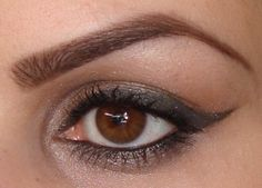 Taupe shimmer eye shadow look with winged liner for deep set