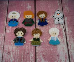 Frozen Finger Puppet Set.  Made with felt with my embroidery machine. Made with quality acrylic felt. No wool felt was used to make these puppets.   Buy 4 and get 1 free!! Let me know on note to seller which finger puppet you would like for free! These items are made to order. Please allow 5-7 business days to be shipped out. Follow us on Facebook. www.facebook.com/marysdaughters