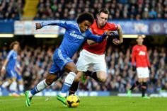 Willian and Phil Jones do battle...