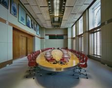 """Jacqueline Hassink The meeting table of the Board of Directors of Royal Dutch Shell (June 7, 2010) Chromogenic prints 50 x 63""""  Edition of 10 23 x 28""""  Edition of 10"""