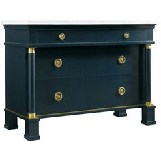 The three drawer Hartman Chest features an exquisite deep cobalt blue finish with an elegant heavy white marble top, solid brass hardware and fittings, and iconic front columns.