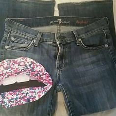 7 for All Mankind boot cut jeans. Super soft and comfy 7 for All Mankind sz 26 low rise  boot cut medium wash jeans. Only soft fraying at cuff as picture. Otherwise perfect condition. 7 for all Mankind Jeans Boot Cut