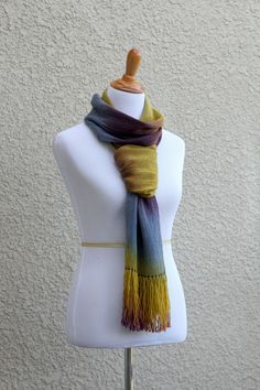 Hand woven scarf with gradually changing colors from #mustard and gold to #blue and purple. Amazing color shades and color variety. This woven scarf is also wide enough to us... #kgthreads #accessories #cozy #fall #fashion #gift #gradient #purple #unisex #women #wrap