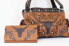 Western purse~This beautiful purse is a gorgeous light coral with a large longhorn and rhinestone accents.  Comes with matching wallet!