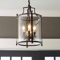 Check out Heritage Hanging Lantern from Shades of Light A classic lantern in rich blackened bronze on a steel frame that houses curved glass panels that are lightly seeded for an antiqued appearance. A clean, simple addition to your classic entryway, or p Entryway Chandelier, Entryway Lighting, Lantern Chandelier, Hanging Lanterns, Hanging Lights, Lantern Lighting, Chandelier Shades, Chandelier Lighting, Entryway Decor