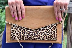 The KJones Collection animal print clutch