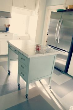 """My Old Country House did a DIY kitchen island using Formica® 180fx® Laminate - Calacatta Marble. Check it out!  """"DIY Kitchen Island with wheels and Formica CALACATTA MARBLE top to match the counters. I got the AEGEAN on two sides and just the """"old fashioned"""" straight edge on the remaining two edges."""""""