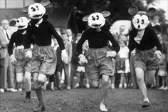 Masked members of the Mickey Mouse Club taking part in a race at Guildford, during the Mickey Mouse Club Annual Sports Day.  August 17, 1938