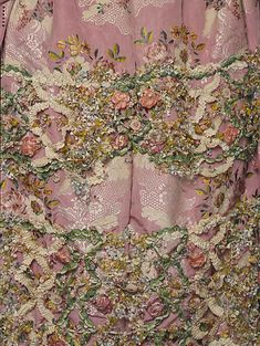 Detail of the decoration, robe à la Française, France, 1750-1775. Silk brocade with floral design.