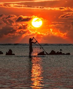 Paddle boarding off the shore of Ko Olina, Oahu at sunset.