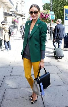 The always #fashionable Olivia #Palermo shows off an #emerald #blazer and #yellow #jeans.  What an adorable #street #style!
