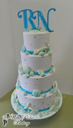 https://flic.kr/p/tbDaro | Sea Shell themed four tier wedding cake