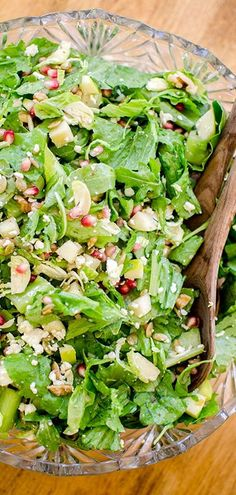 Thanksgiving chopped salad with a maple-shallot vinaigrette has arugula, apples, walnuts, pepitas, and brussels spouts in it for the perfect fall salad.