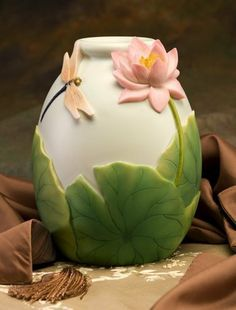 Dragonfly & Waterlily Hand Painted Vase - Ibis & Orchid by Ibis & Orchid. $32.99. Optional Companion Pcs available. Hand Painted. 7 Inch X 8.5 Inches. Durable Bonded Marble. Exceptional Detail. This beautiful vase will serve as a soft, naturalistic accent with an air of fantasy while resting atop your coffee table or countertop.
