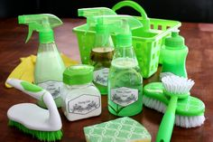 Homemade cleaning kit with cleaning recipes for multi purpose cleaner, furniture spray, fabric refresher, soft scrub and includes free printable labels