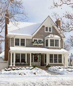 What a pretty house.  I like the porch and bay window