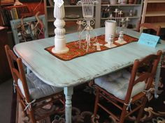 Vintage Pale Turquoise Painted Distressed Shabby Chic Dining Table & a Set of 4 Maple Dining Chairs with Satiny Pale Turquoise Seat Cushions that pull the look all together!  Priced at $495.  Can be seen @ Promise Land Antique Mall 721 Kihekah Ave. Pawhuska, OK or call 918-287-9120.  For more info. visit my facebook page , Promise Land Antique Mall