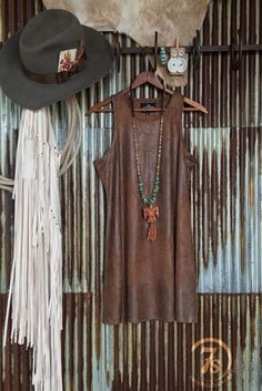 The Ranchos - Distressed faux leather tunic/dress. Rustic looking faux leather. Rich variation in color. Sleeveless. Soft with a good amount of stretch. Great layering piece as a tunic.