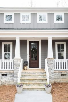 Farmhouse Exterior: Craftsman Porch Pillars with stone and porch railing. Gray House Exterior, House With Porch, House Siding, Exterior Wall Design, House Exterior, Exterior Design, Craftsman Porch, Front Porch Stone, Exterior Stone